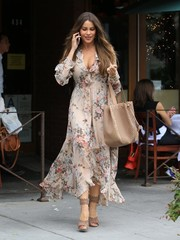 Sofia Vergara topped off her monochromatic look with an oversized nude tote, also by Alaia.