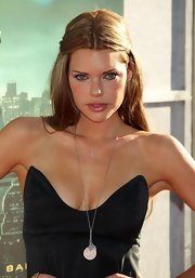Sophie Monk paired her strapless black dress with a silver pendant necklace.