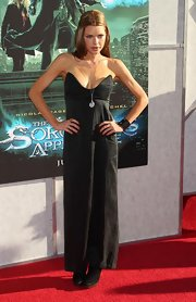 Sophia Monk paired her long silver pendant necklace with a plunging strapless black dress.