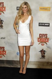 Marisa Miller showed off her super model figure in a white bandage dress.