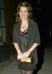 Nia Vardalos added instant glamour to her look with a gold rectangular clutch.