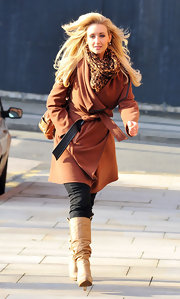 Catherine Tyldesley warmed up in a chic rust coat and a complementary leopard print scarf.