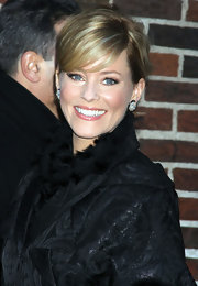 Elizabeth Banks wore her hair in a sleek updo with side-swept bangs while heading to the 'Late Show With David Letterman.'