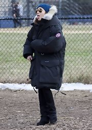 Noomi Rapace was all geared up for cold weather in a bulky black down coat while filming 'Animal Rescue' in NYC.