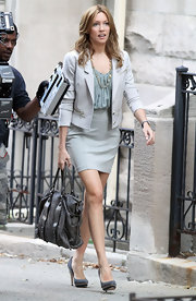 Katie looked sophisticated-chic in a neutral skirt suit with slate blue pumps.