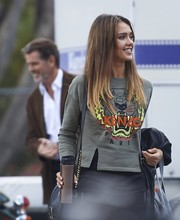 Jessica Alba arrived on set wearing a tiger-embroidered sweatshirt by Kenzo.