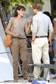 French first lady Carla Bruni-Sarkozy looked low-key in a pair of relaxed fitting khakis worn with a classic brown belt.