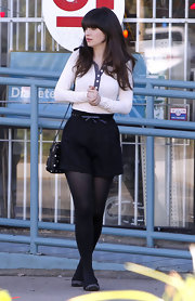 Zooey Deschanel emphasized her hourglass shape in a pair of black high-waist trouser shorts with a darling bow belt.