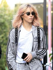Suki Waterhouse stepped out on a sunny day wearing a pair of oval sunglasses by The Row.