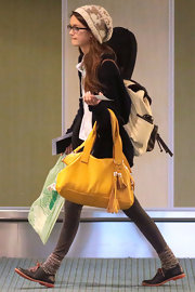 Ciara Bravo's tasseled mustard tote was a bright addition to her ensemble.