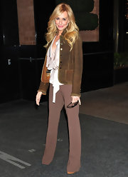 Taylor Armstrong turned heads in NYC wearing crepe mocha slacks and a brown suede jacket.