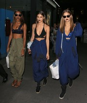 Jasmine Tookes teamed a black DKNY bra with a half-down jumpsuit for night out in New York City.