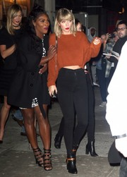 Taylor Swift flashed a bit of tummy in a rust-colored cropped sweater by Elizabeth and James while enjoying a night out.