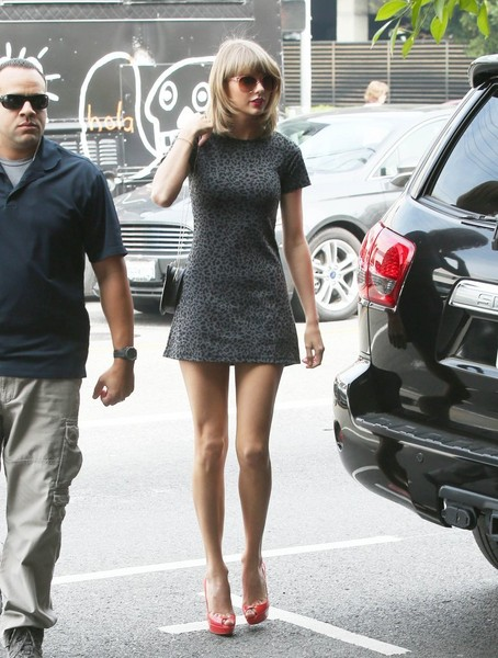 Taylor Swift flaunted her $40-million legs in a super-short leopard-print dress by Reformation while heading to a lunch date.
