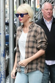 Taylor Swift enjoyed a day out in New York City wearing cute blue Local Supply Freeway shades.