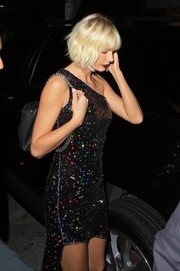 Taylor Swift looked totally party-ready in a Haney one-shoulder dress rendered in multicolored sequins.