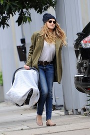 Teresa Palmer layered an olive-green wool coat over a plain white shirt for a day out in Los Angeles.