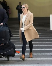 Teresa Palmer exuded effortless elegance in a timeless camel coat.