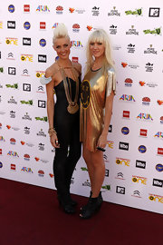 Mim Nervo upped the wow-factor in this black leather bodysuit accessorized with dramatic body jewellery.
