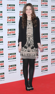Georgie Henley donned whimsical black satin Bowie pumps with the words 'let's dance' written across the toes.