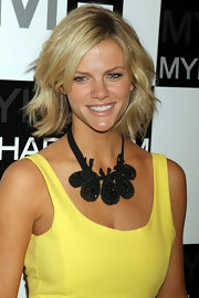 Brooklyn Decker amped up her neckline with a black rhinestone encrusted necklace. Her statement necklace was a great way to add contrast her her canary dress.