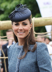 The Duchess looked delightful in this navy hat and blue tweed blazer.