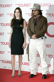 Johnny wears a rugged leather jacket for 'The Tourist' premiere in Berlin.