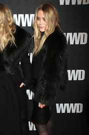 Mary-Kate and her sister are clearly not opposed to the fur trend. She dons an all black ensemble, wearing a coat with a full sleeve of fur.