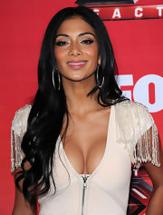 Nicole Scherzinger wore her long hair with a sleek center part and tousled waves at a press conference for The X Factor.