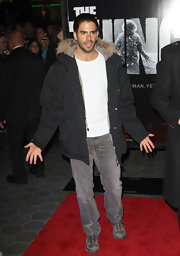 Eli Roth jazzed up his shirt and jeans ensemble with a fur-hooded parka.