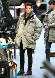 Logan Henderson bundled up in a cozy beige down jacket during a 'Big Time Rush' shoot.