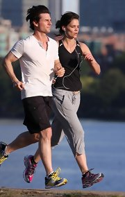 Katie sets the pace with hubby Tom Cruise in her red and grey New Balance sneakers.