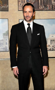 Tom Ford paired his black suit with a subtle dotted tie.
