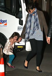 "These blue metallic ""Georges"" flats match Suri's pink ones."