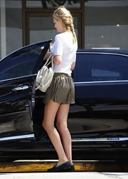 Toni Garrn picked up coffee in Hollywood while wearing stylish gold lame' shorts.