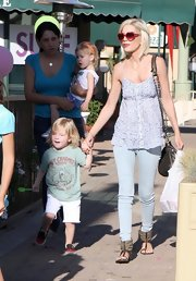 Tori rocked playful, heart-shaped sunglasses while spending the day with her kids.