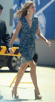 Trinny Woodall showed off her shapely legs and slim figure in a stylish blue print dress while touring Australia.