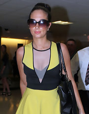 Tulisa Contostavlos arrived in Miami wearing her hair in a chic bun.