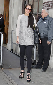 Tulisa Contostavlos tossed on this glittering mod coat for her visit to BBC Radio 1.