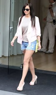 A pale pink blazer gave Tulisa Contostavlos a bright and feminine look while stepping out in California.