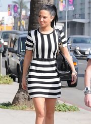 Tulisa Controstavlos chose a cool mod-style, striped dress while out and about in Hollywood.