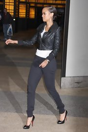 "The 5'10""  former supermodel gave herself an unneeded height boost in a super high pair of black leather pumps. This classic shoe looked hot with her black skinny pants and complemented her black leather bomber jacket."