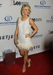 Julianne posed in timeless nude peep toe pumps. She paired the heels with a white feathered dress.