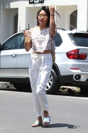 Vanessa Hudgens completed her breezy look with white drawstring pants.