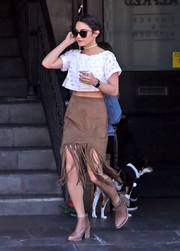 Vanessa Hudgens teamed her cute top with a fringed brown pencil skirt by Tularosa.