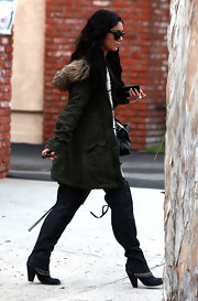 Vanessa Hudgens bundled up in Burbank in an olive twill bomber coat with a faux fur hood.