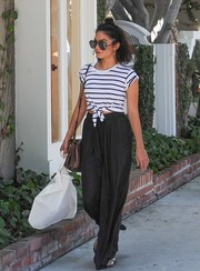 Vanessa Hudgens chose black wide-leg pants to seal off her look.