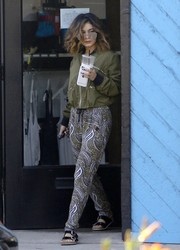 Vanessa Hudgens teamed black Birkenstocks with print pants and a bomber jacket for a day of shopping in LA.