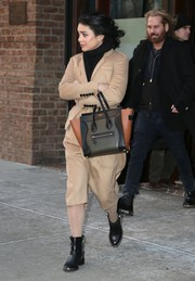 Vanessa Hudgens teamed black Dolce Vita moto boots with a beige coat and a Celine bag for her visit to 'Live with Kelly and Michael.'