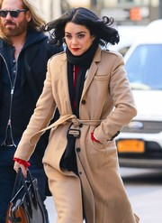 Vanessa Hudgens looked toasty in a black scarf and a beige wool coat while out in New York.